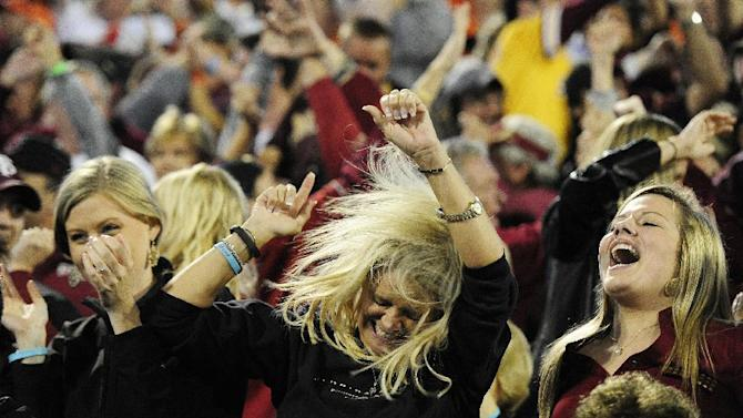 Florida State fans celebrate a Florida State touchdown against Clemson during the first half of an NCAA college football game, Saturday, Oct. 19, 2013, in Clemson, S.C