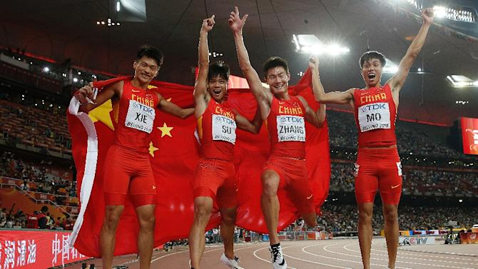 (L-R) China's Xie Zhenye, China's Su Bingtian, China's Zhang Peimeng and China's Mo Youxue celebrate after coming a shock second in the final of the 4x100 metres relay at the 2015 World Championships in Beijing on August 29