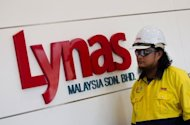 An engineer walks past a Lynas signboard at the Lynas plant administrative office in Gebeng, some 270 km east of Kuala Lumpur. Australian miner Lynas Corp recently received a preliminary license to operate the plant in eastern Malaysia, which will process rare earths imported from the Mount Weld mine in Western Australia