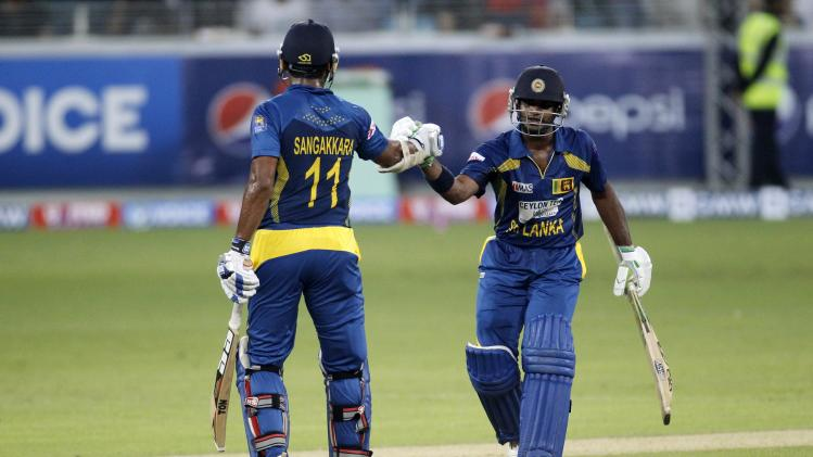 Sri Lanka's Perera and Sangakkara have a chat during their second Twenty20 international cricket match against Pakistan in Dubai