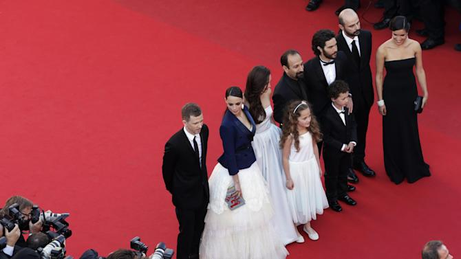 From left, producer Alexandre Mallet-Guy, actress Berenice Bejo, actress Pauline Burlet, actress Jeanne Jestin, director Asghar Farhadi, actor Elyes Aguis, actor Tahar Rahim, actor Ali Mosaffa and actress Sabrina Ouazani pose for photographers as they arrive for the screening of the film The Past at the 66th international film festival, in Cannes, southern France, Friday, May 17, 2013. (AP Photo/David Azia, Pool)