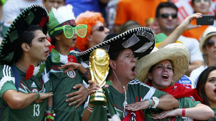 Fans of Mexico sing the national anthem before their 2014 World Cup round of 16 game against the Netherlands at the Castelao arena in Fortaleza
