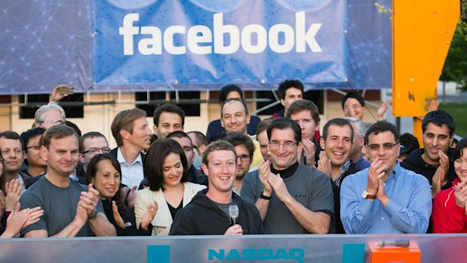 FILE - In this May 18, 2012, file photo, provided by Facebook, Facebook founder, Chairman and CEO Mark Zuckerberg, center, rings the opening bell of the Nasdaq stock market, from Facebook headquarters in Menlo Park, Calif. Amid the hype and excitement surrounding Facebook's initial public offering, there were looming doubts. Potential investors wondered whether the social network could continue growing its advertising revenue without alienating users. One year later, much has changed at Facebook in a year, including the addition of mobile advertisements, the launch of a search feature and the unveiling of a branded smartphone. (AP Photo/Nasdaq via Facebook, Zef Nikolla, File)