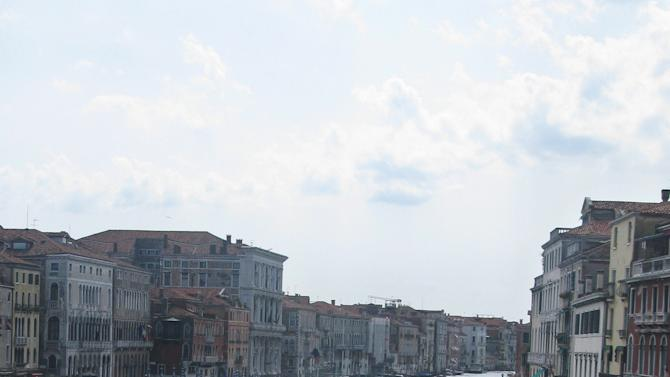 This July 15, 2012 photo shows Gondolas jockeying for position on the Grande Canale in the heart of Venice, Italy. To travel through northern Italy with a copy of Mark Twain's 1869 ''The Innocents Abroad', his classic 'record of a pleasure trip'. It took him to the great sights of Europe and on to Constantinople and Jerusalem before he sailed home to New York. Such a trip would take far too big a chunk out of my holiday time. But, Milan, Florence and Venice, a mere fragment for Twain, was within my reach for a two-week vacation. (AP Photo/Raf Casert)