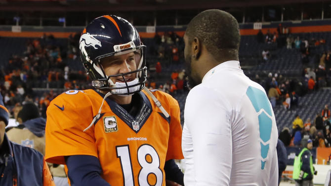 Denver Broncos quarterback Peyton Manning (18) greets Miami Dolphins linebacker Chris McCain after an NFL football game, Sunday, Nov. 23, 2014, in Denver. The Broncos won 39-36