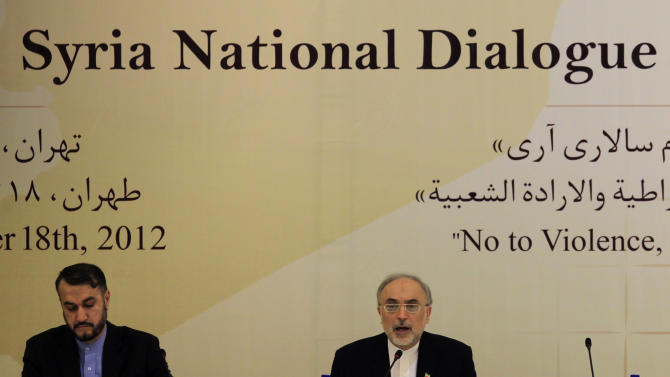 """Iranian Foreign Minister, Ali Akbar Salehi, right, speaks during the """"Syria National Dialog"""" conference, as his deputy minister Hossein Amir Abdollahian, sits at left, at the Esteghlal Hotel in Tehran, Iran, Sunday, Nov. 18, 2012. Iran held Sunday a conference to reconcile Syria's government with opposition factions and end the country's civil war, the official IRNA news agency reported. (AP Photo/Vahid Salemi)"""