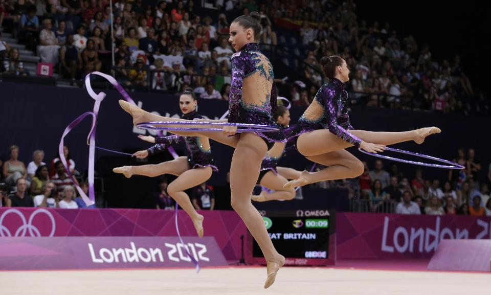 The team from Britain performs during the rhythmic gymnastics group all-around qualifications at the 2012 Summer Olympics, Friday, Aug. 10, 2012, in London. (AP Photo/Julie Jacobson)