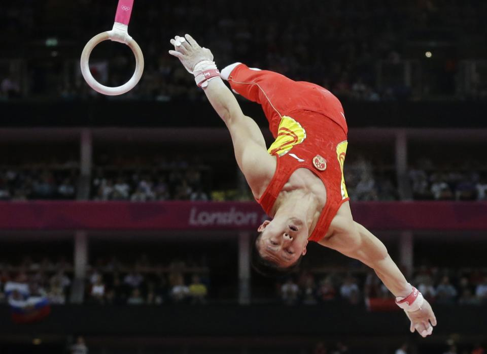 Chinese gymnast Chen Yibing performs on the rings during the Artistic Gymnastic men's team final at the 2012 Summer Olympics, Monday, July 30, 2012, in London. (AP Photo/Julie Jacobson)