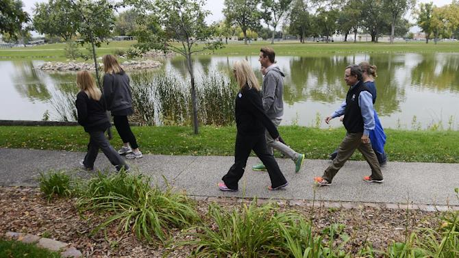 Sioux Empire United Way employees walk from their office to the Japanese Gardens on Sept. 30, 2014 in Sioux Falls, S.D. and back every day at 10am and 2:30 PM as part of a employee walking program that has been going on for 10 years, Sept 30, 2014. They work at Sioux Empire United Way and participate in an employee walking program that has been going on for 10 years. (AP Photo/Argus Leader, Elisha Page)