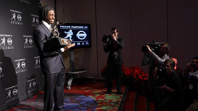 Heisman Trophy winner Robert Griffin III, of Baylor, holds the award during a news conference, Saturday, Dec. 10, 2011, in New York. The junior quarterback known as RG3 became the first Heisman winner from Baylor. (AP Photo/Craig Ruttle)