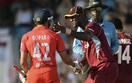 West Indies' Sammy shakes hands with England's Bopara during the first T20 international cricket match at Kensington Oval in Bridgetown