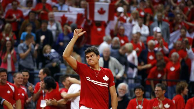 Canada's Raonic celebrates his victory over Serbia's Tipsarevic after their Davis Cup semi-final tennis match in Belgrade