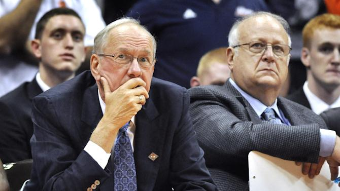 FILE - In this Nov. 14, 2011 file photo, Syracuse basketball coach Jim Boeheim, left, watches the action with assistant coach Bernie Fine,  during a college basketball game against Manhattan in the NIT Season Tip-Off in Syracuse, N.Y. Federal authorities have dropped their investigation into sexual abuse claims that cost a Syracuse University assistant basketball coach his job, threw a top-ranked team into turmoil and threatened the career of Hall of Fame coach Boeheim. After a probe spanning nearly a year, U.S. Attorney Richard Hartunian said Friday, Nov. 9, 2012 there was no evidence to support claims that Bernie Fine had molested a boy in 2002 in a Pittsburgh hotel room.  (AP Photo/Kevin Rivoli, File)