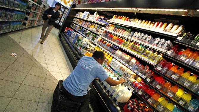 An employee stocks shelves at a Walgreens store in New York City
