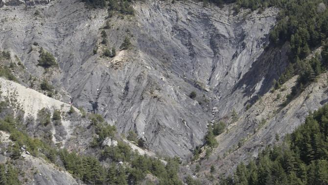 A view of the crash site near Seyne-les-Alpes, France, Monday, March 30, 2015.  European investigators are focusing on the psychological state of a 27-year-old German co-pilot who prosecutors say deliberately flew a Germanwings plane carrying 150 people into a mountain, a French police official said Monday. (AP Photo/Claude Paris, Pool)