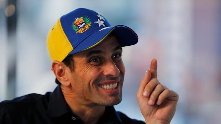 In this Feb. 25, 2014 photo, Opposition leader and Miranda's State governor Henrique Capriles gestures during an interview at his office in Caracas, Venezuela. Capriles says the opposition has put its differences over strategy behind them, adding that the government may have miscalculated its response to the protests as well. (AP Photo/Fernando Llano)
