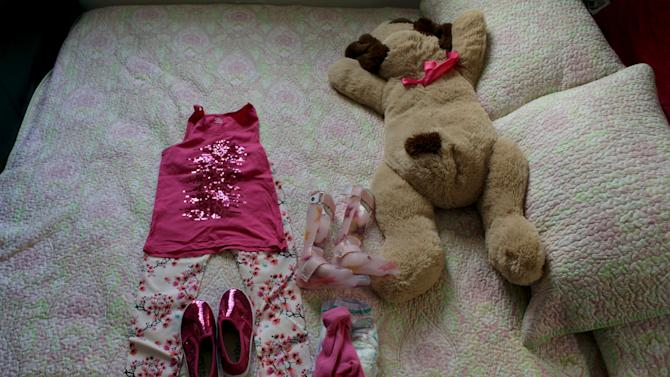 The clothes of Graciela Elizalde, a girl who suffers from Lennox-Gastaut syndrome, a debilitating form of epilepsy, are displayed on a bed at her house in Monterrey