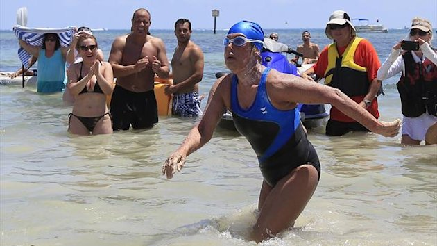 US long-distance swimmer Diana Nyad , 64, walks to dry sand, completing her swim from Cuba as she arrives in Key West, Florida, September 2, 2013 (Reuters)
