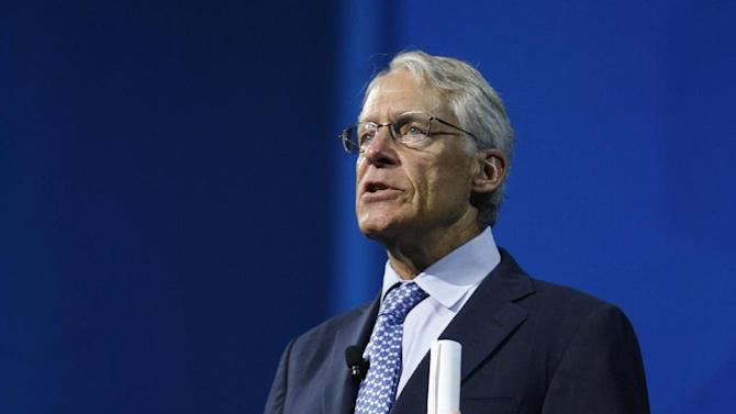 Walmart Chairman Rob Walton speaks to a crowd of shareholders from around the world during the Wal-Mart shareholders meeting in Fayetteville, Ark., Friday, June 7, 2013. (AP Photo/Gareth Patterson)