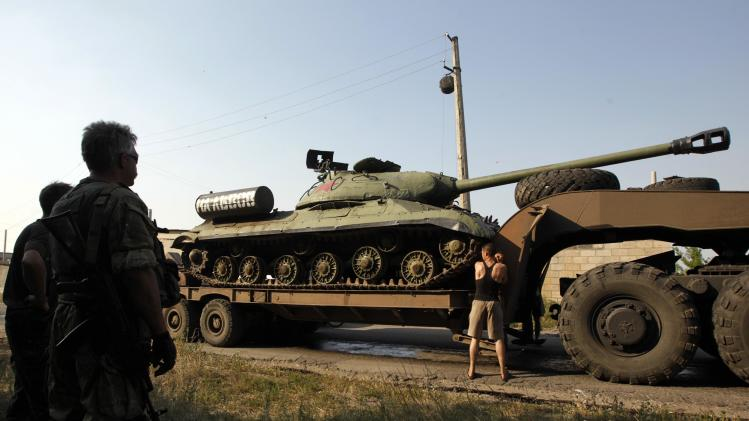 Ukrainian servicemen transport a JS-3 (IS-3) World War Two tank seized from pro-Russian separatists in the eastern Ukrainian town of Kramatorsk