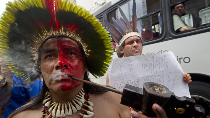 Brazilians protest against the privatization of the Maracana stadium, in Rio de Janeiro, Brazil, Saturday, Dec. 1, 2012. About 500 people, including Indians and students, protested Saturday, against privatization of the stadium because it will lead to the demolition of a nearby museum and a public school. (AP Photo/Silvia Izquierdo)