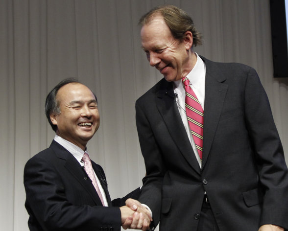 Softbank Corp. President Masayoshi Son, left, and Sprint Nextel Corp. Chief Executive Dan Hesse shake hands during their joint press conference in Tokyo Monday, Oct. 15, 2012. Tokyo-based mobile carrier Softbank has reached a deal with Sprint to acquire 70 percent of the U.S. wireless company for $20.1 billion in the largest ever foreign acquisition by a Japanese company. (AP Photo/Koji Sasahara)
