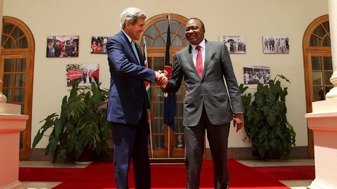 U.S. Secretary of State Kerry shakes hands with Kenyan President Kenyatta following a meeting at the State House in Nairobi