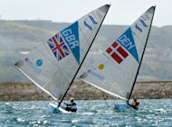 Britain races Denmark at the London Games. Olympic fever has had a positive effect on sailing holiday booking this year
