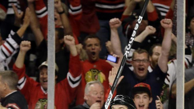 Chicago Blackhawks center Andrew Shaw (65) celebrates after scoring the winning goal during the third overtime period of Game 1 in their NHL Stanley Cup Final hockey series against the Boston Bruins, Thursday, June 13, 2013, in Chicago. (AP Photo/Nam Y. Huh)