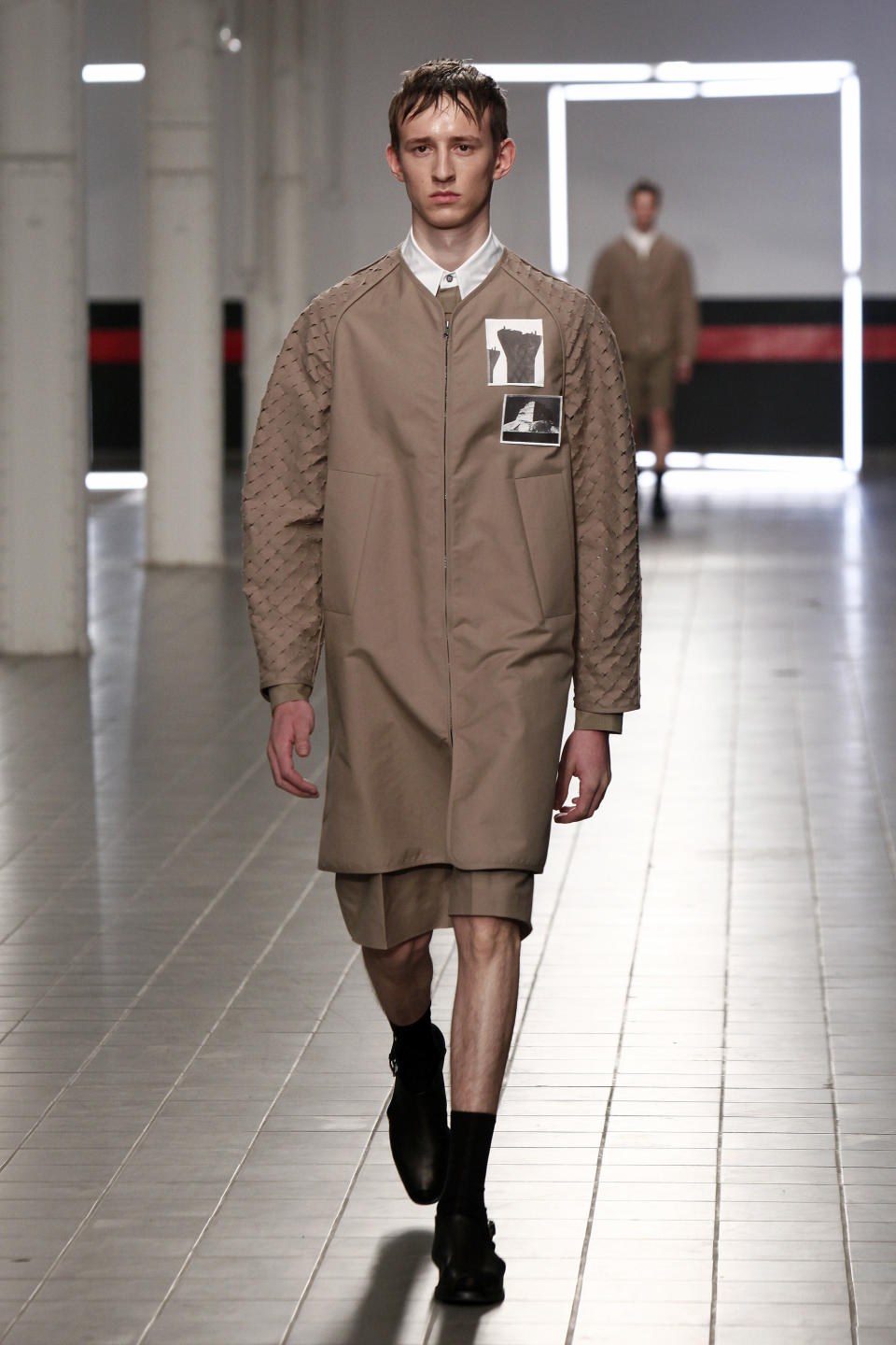 A model presents a creation by German fashion designer Damir Doma as part of his men's fashion Spring-Summer 2014 collection, presented Saturday, June 29, 2013 in Paris. (AP Photo/Thibault Camus)