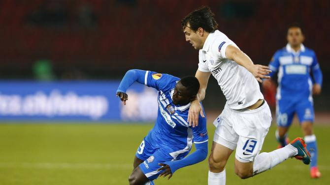 FC Zurich's Nef challenges Angelis of Apollon Thuram during their Europa League Group A soccer match in Zurich