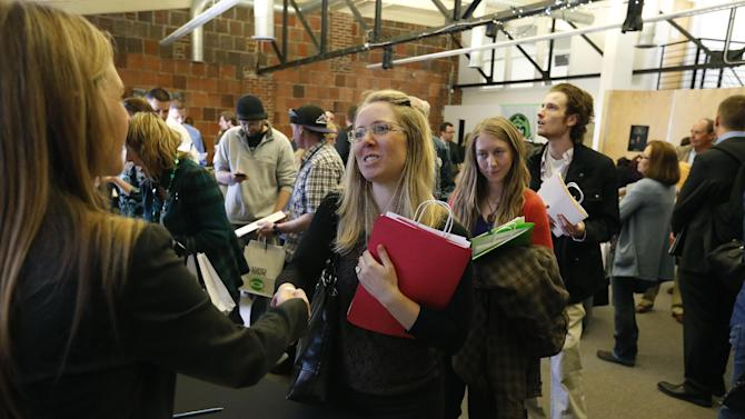 FILE In this Thursday March 13, 2014, file photo, job seekers attend a marijuana industry job fair hosted by Open Vape, a vaporizer company, in Downtown Denver. The Labor Department releases weekly jobless claims on Thursday, March 20, 2014. (AP Photo/Brennan Linsley)