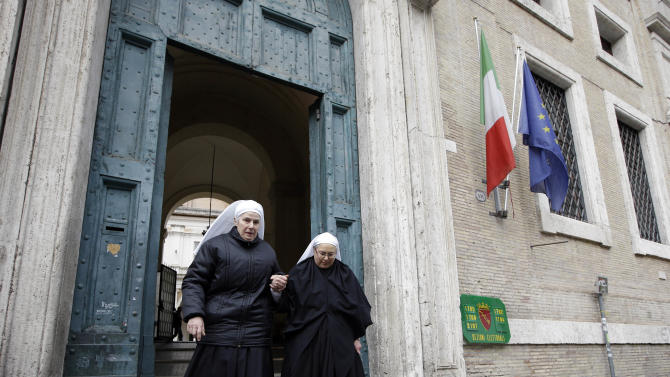Nuns leave a polling station after voting in downtown Rome, Sunday, Feb. 24, 2013. Italy votes in a watershed parliamentary election Sunday and Monday that could shape the future of one of Europe's biggest economies. (AP Photo/Andrew Medichini)