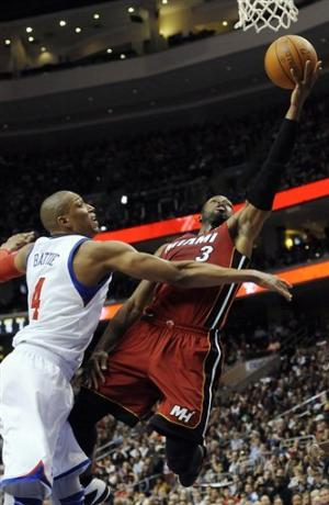 Heat use late run to top 76ers 99-79