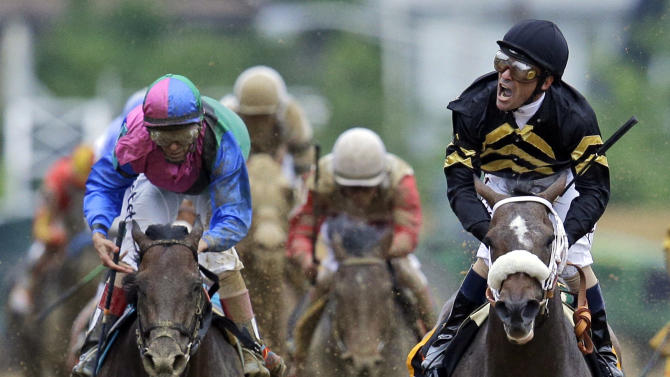 Jockey Gary Stevens celebrates aboard Oxbow after winning the 138th Preakness Stakes horse race at Pimlico Race Course, Saturday, May 18, 2013, in Baltimore. Orb, the Kentucky Derby winner, trails at center and finished fourth. (AP Photo/Patrick Semansky)