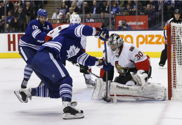 Ottawa Senators goalie Bishop makes a save on Toronto Maple Leafs Komarov during the second period of their NHL hockey game in Toronto