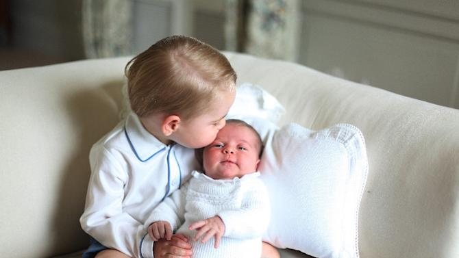 A picture released by Kensington Palace and taken by Britain's Catherine, Duchess of Cambridge, in May 2015, shows Prince George of Cambridge (L) and Princess Charlotte of Cambridge at Anmer Hall in Norfolk, England