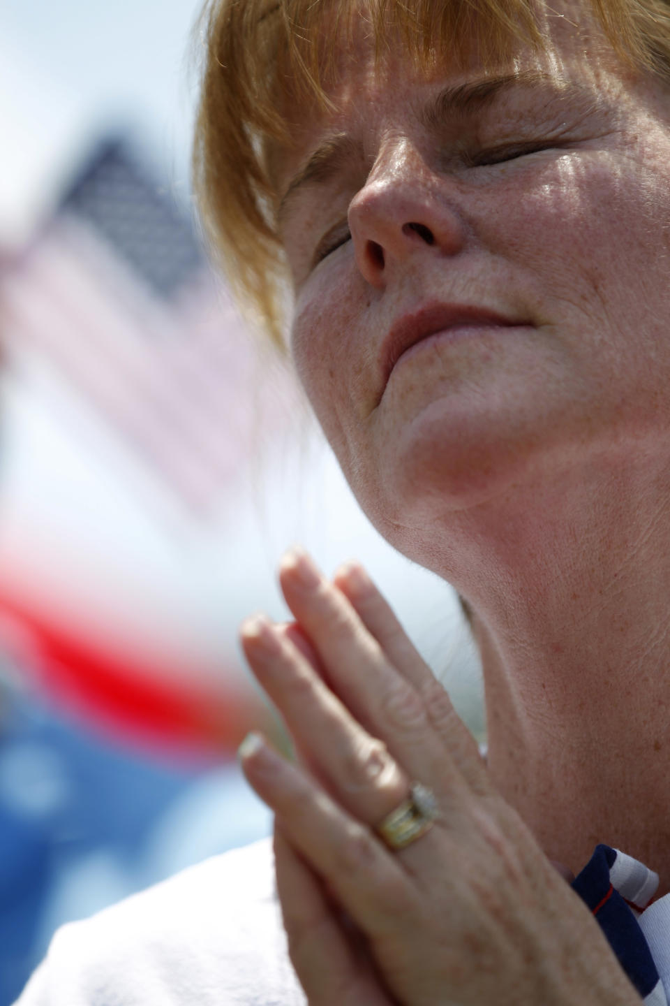 Deb Mirenda of Coatesville, Pa. closes her eyes as she listens to a speaker, during a protest against the Obama administration mandate that employers provide workers birth control coverage, at Independence Mall, Friday, June 8, 2012, in Philadelphia. The event was organized by Stand Up For Religious Freedom. (AP Photo/Matt Rourke)