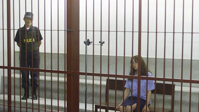 File picture of U.S. citizen Berenson listening to judges from behind bars in a concrete cell in Lima
