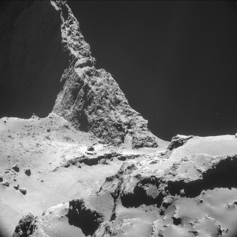 The picture taken with the navigation camera on Rosetta and released by the European Space Agency ESA shows the boulder-strewn neck region of Comet...