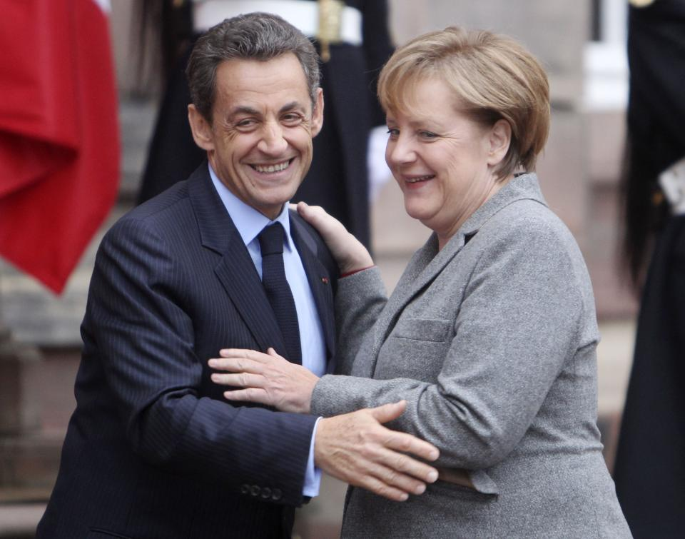 German Chancellor Angela Merkel and French President Nicolas Sarkozy say good bye after their meeting in Strasbourg, France, Thursday, Nov. 24, 2011. The leaders of Germany, France and Italy are set for a debate about the European Central Bank's  role in region debt crisis and on how to align eurozone economic policies.(AP Photo/Michael Probst)