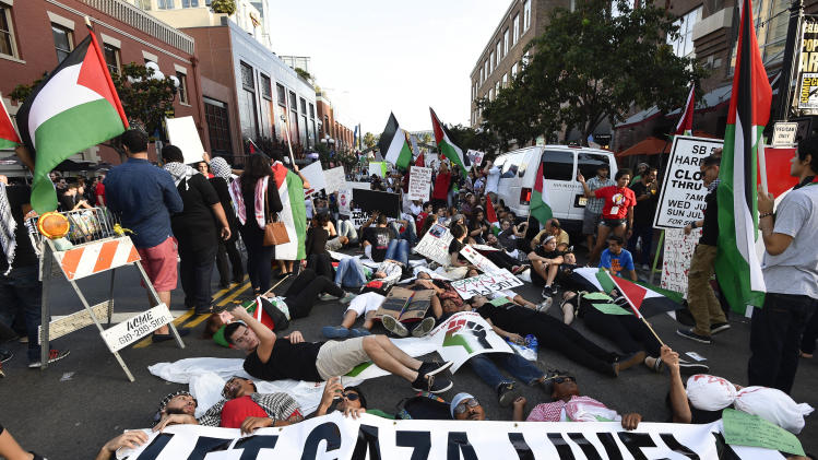 Pro-Palestinian protestors block Fifth Avenue in the Gaslamp Quarter outside of the San Diego Convention Center on Day 2 of the 2014 Comic-Con International Convention held Friday, July 25, 2014, in San Diego. (Photo by Denis Poroy/Invision/AP)