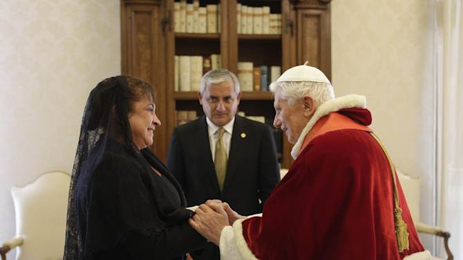 Pope Benedict XVI  receives Guatemala's President Otto Perez Molina, center, and his wife Rosa Perez, left, during a private audience at Vatican, Saturday, Feb. 16, 2013. (AP Photo/Alessandra Tarantino,  pool)