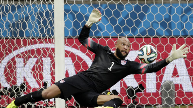 United States' goalkeeper Tim Howard saves a shot by Belgium during the World Cup round of 16 soccer match between Belgium and the USA at the Arena Fonte Nova in Salvador, Brazil, Tuesday, July 1, 2014. (AP Photo/Felipe Dana)