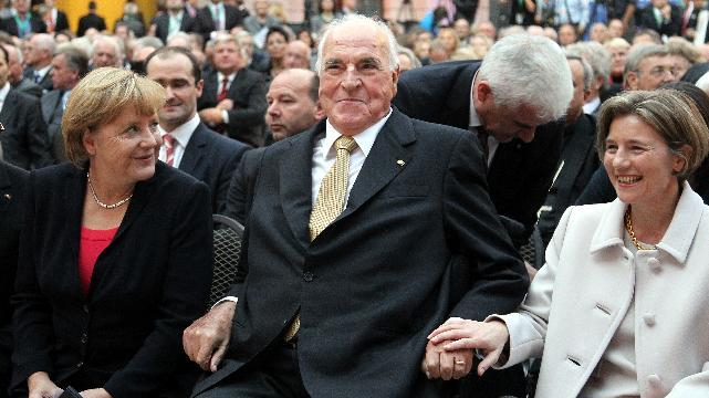 German Chancellor Angela Merkel, former German Chancellor Helmut Kohl and his wife Maike Richter-Kohl, from left, talk before a ceremony marking the 30th anniversary of Kohl becoming West Germany's leader in Berlin, Thursday, Sept. 27, 2012. (AP Photo/Wolfgang Kumm, pool)