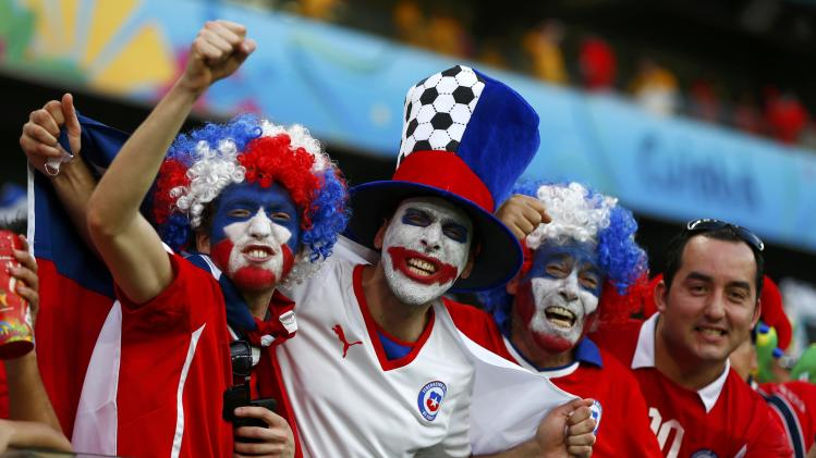 Chile fans wait for the start of their 2014 World Cup Group B soccer match against Australia at the Pantanal arena in Cuiaba