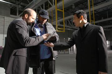 Jason Statham , director Philip G. Atwell and Jet Li on the set of Lionsgate Films' War