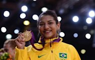 Brazil's gold medalist Sarah Menezes poses on the podium after the women's -48 kgs contest of the judo event at the London 2012 Olympic Games