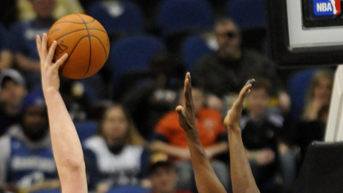 Minnesota Timberwolves' Kevin Love, left, shoots over Utah Jazz's Jeremy Evans in the first half of an NBA basketball game Friday, March 11, 2011 in Minneapolis. (AP Photo/Jim Mone)