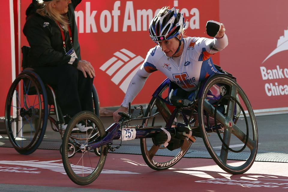 Tatyana McFadden, of Champaign, Ill., wins the woman's wheelchair division during the Chicago Marathon on Sunday, Oct. 13, 2013, in Chicago. (AP Photo/Andrew A. Nelles)